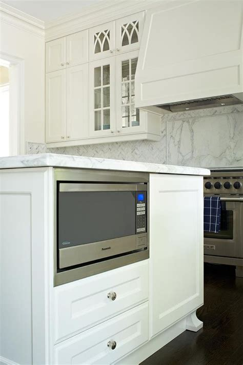 tuck a microwave into your kitchen island for clutter free