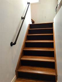 gas pipe railing walnut stairs black risers gas pipes