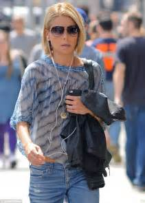 kelly ripa see through kelly ripa reveals her bra and a flash of toned tummy in