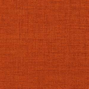 Dark orange solid textured indoor upholstery fabric by the