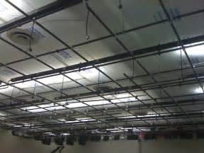an object is suspended from the roof of a lift temporary plastic ceiling partitions and enclosures for