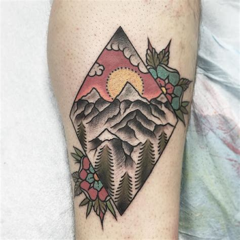traditional mountain tattoo geometric w mountain inside and flowers