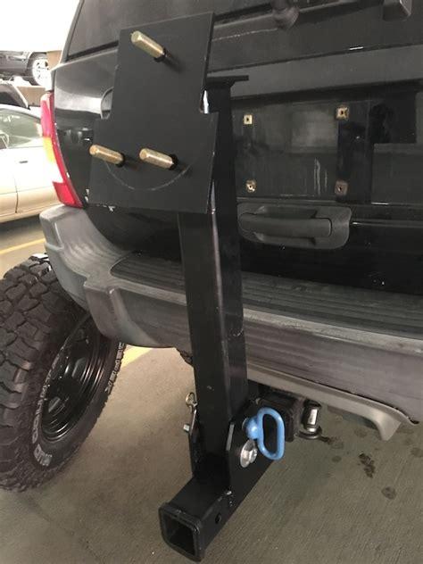 wj fold  spare tire carrier hitch jeepforumcom