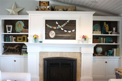tv coverups spring mantel and restyled shelves the pleated poppy