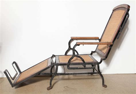 Cast Iron Lounge Chairs circa 1876 rolling walnut and black cast iron chaise