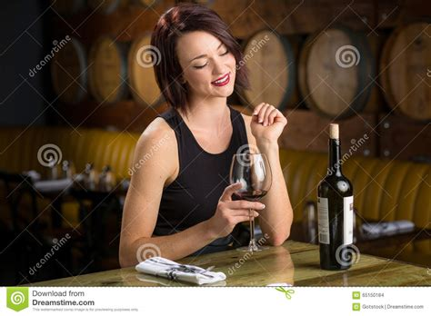 hot date wine single woman on a date with wine glass flirting at