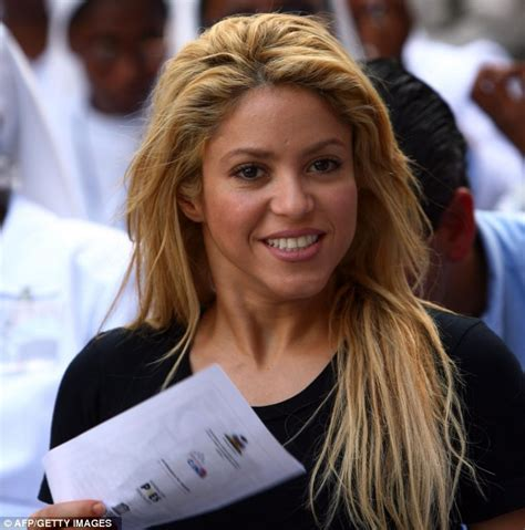 lipstick wore by shakira on commercial shakira displays her famous dance moves as she donates
