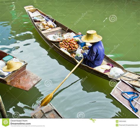 selling a boat selling food on a boat at floating market thailand stock