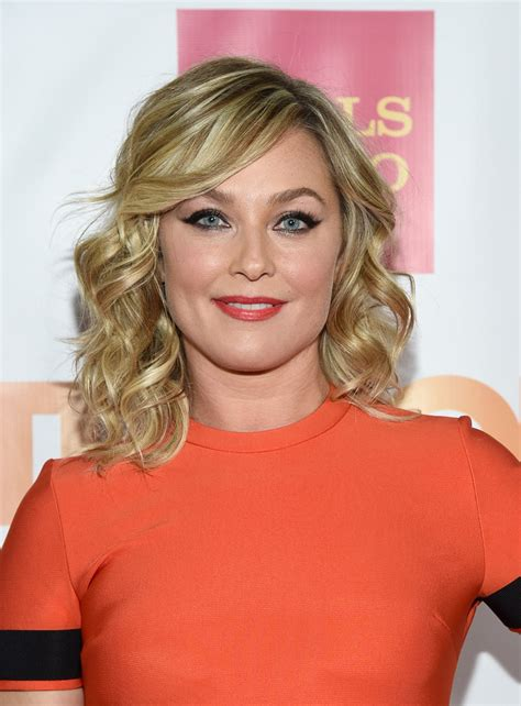 elisabeth rohm medium wavy cut with bangs shoulder