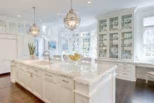long kitchen island with two lanterns transitional kitchen