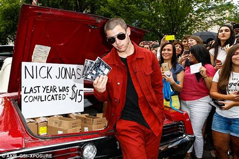 Is Nick Helping Put Out An Album by Nick Jonas Takes To The Streets Of Nyc In His Vintage