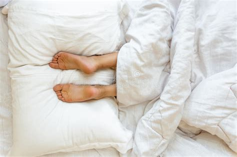Lie For Sound With The Cubic Pillow by Lying On Soft White Pillow At Bed Stock Photo Image