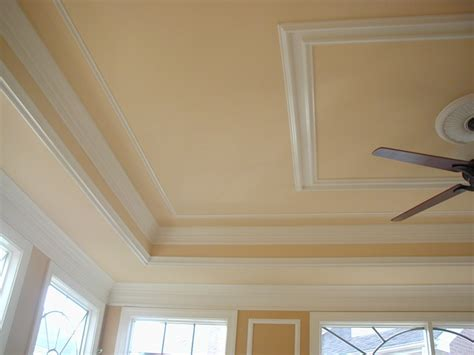 traditional crown molding and tray ceiling