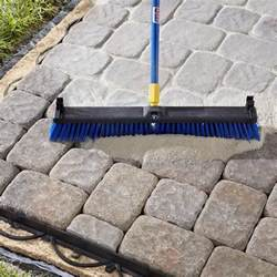 Installing Patio Pavers On Sand Sweeping Polymeric Sand Into Paver Joints Diy Patios Backyard And Yards