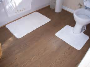 Artistic install floating wood floor in bathroom for wood floor