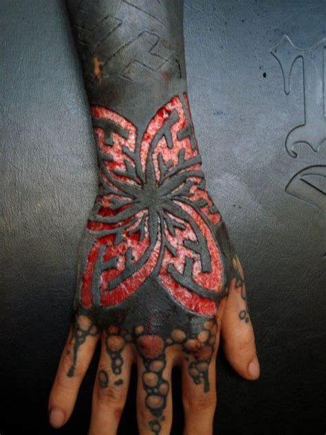 finger tattoo verheilt scarification over black ink tattoos and such from