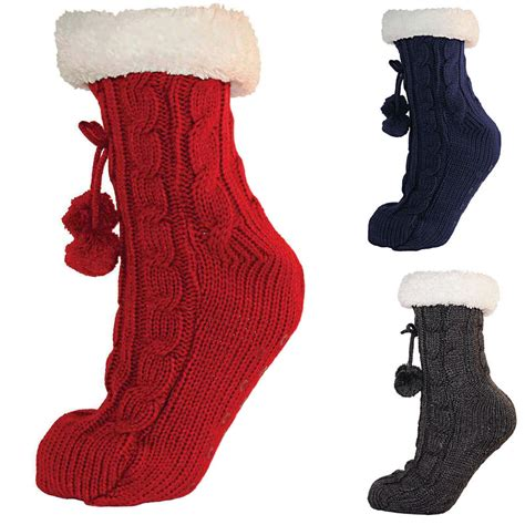 cable knit slipper socks cable knit slipper sock with fleece lining pompoms