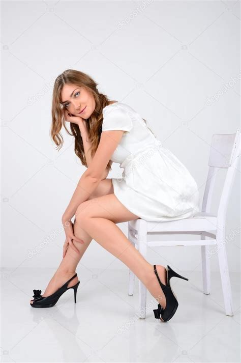 Model Sitting On Chair by A Beautiful Model With Blue Sitting On A White Chair I Stock Photo 169 Milana88 33633657