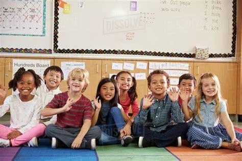 Royalty Free School Children Stock by Elementary School Sitting On Classroom Floor Stock
