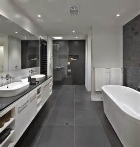 grey and white bathroom ideas bathroom floor to roof charcoal tiles with a black counter and grey cabinets everything else