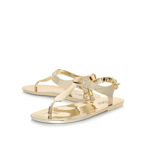 michael kors gold flat shoes mk plate jelly gold flat sandals by michael michael kors