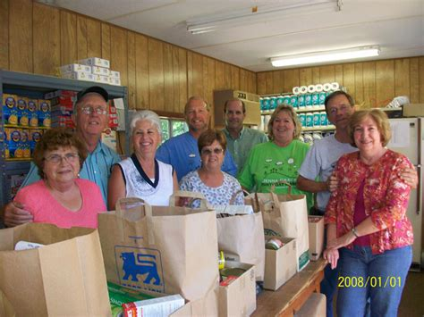 Volunteer At Food Pantry by Food Pantry Proclaiming Grace Outreach