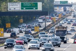 uk drivers stuck in traffic in bank heat