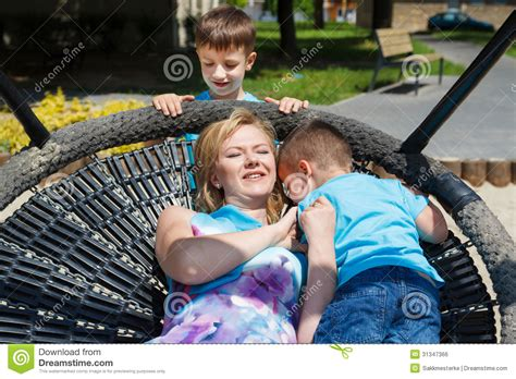 family swing happy family playing in saucer swing royalty free stock