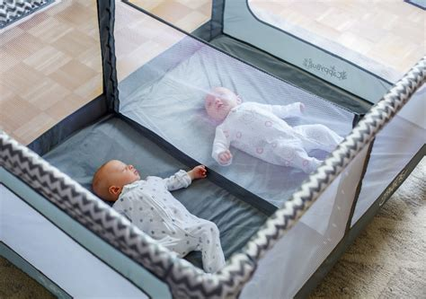 baby double swing for twins romp roost double playpen review video