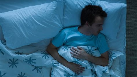 man laying in bed 5 signs you could have a sleep disorder abc news
