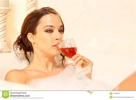lady in a bathtub sad woman drinking in the bath royalty free stock photo