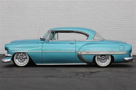 cadillac chevy 54 bel air hardtop lowered with cadillac sombrero hubcaps