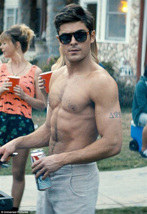 Shirtless Zac Efron Shows Off Rippling Abs, Bulging Biceps, and Surprisingly Hairy Chest In