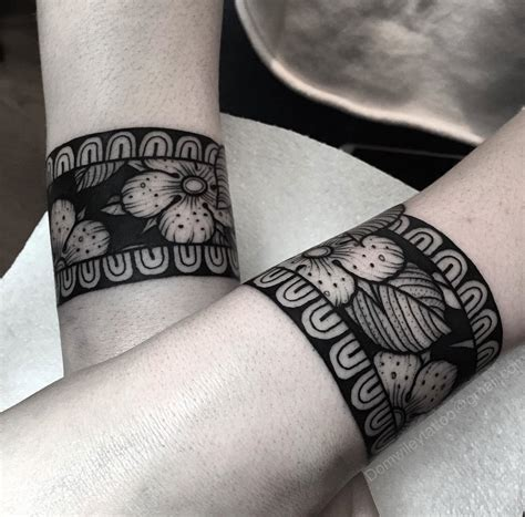 floral bracelet tattoos in black ink best tattoo design