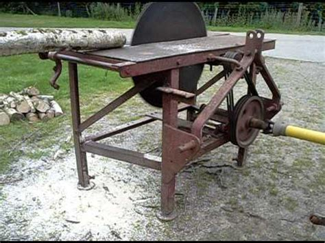 pto saw bench tractor pto driven circular saw bench being driven by grey