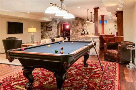 rug pool table if you re planning to an area rug underneath your pool table make sure it s in place