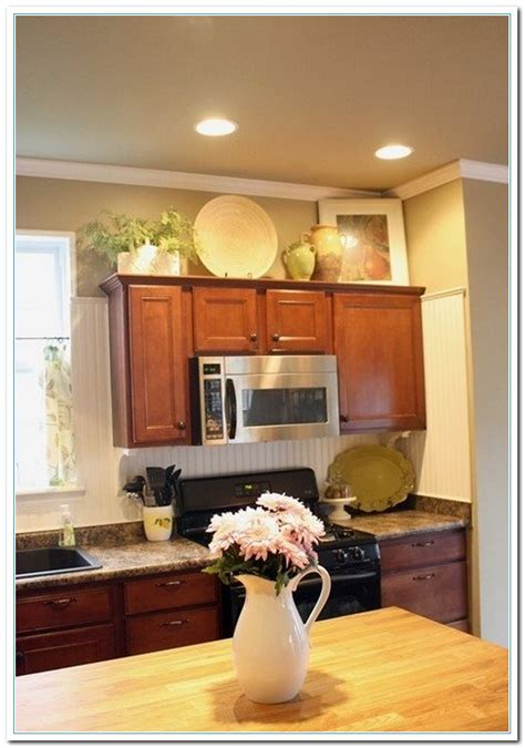 decorating above kitchen cabinets 5 charming ideas for above kitchen cabinet decor home and cabinet reviews
