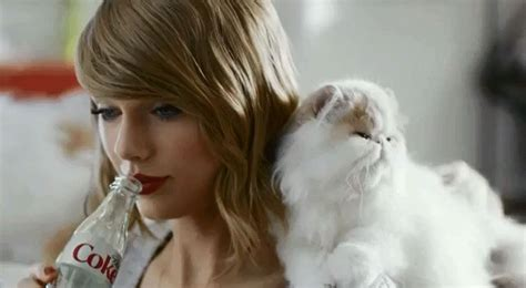 taylor swift cat advertisement taylor swift is covered in kittens in new diet coke ad