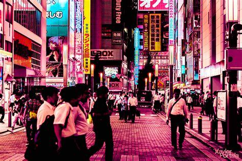xavier portela saturates tokyos sidewalks streets