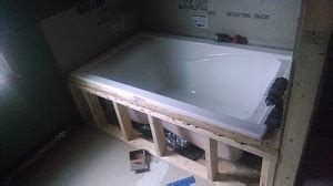 alcove bathtub installation how to tile an undermount tub in an alcove doityourself