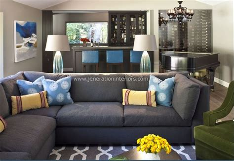 grey sofa with blue pillows grey carpet with grey couch loden green accent chair with