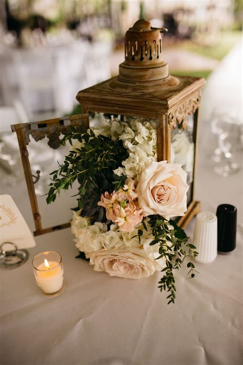 amazing lantern centerpiece with flowers cascading out