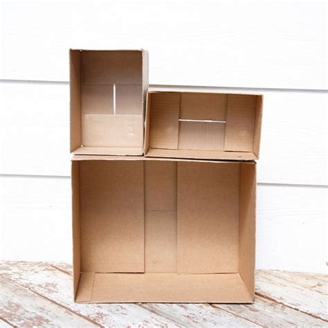 how to make a cardboard house for dolls diy cardboard dollhouse non toy gifts