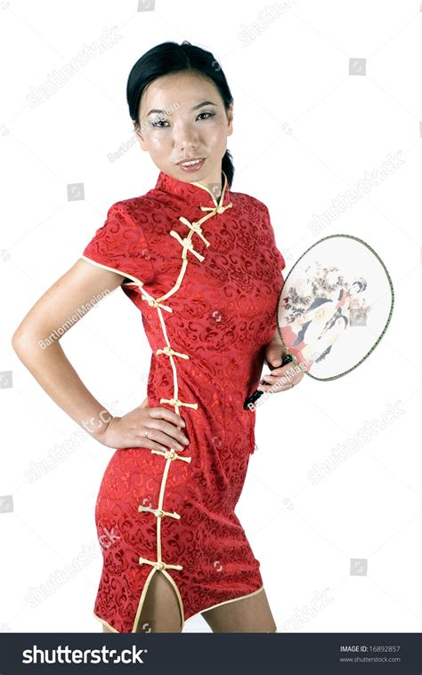 asian girl in traditional chinese dress called qipao holding simple fan stock photo 16892857