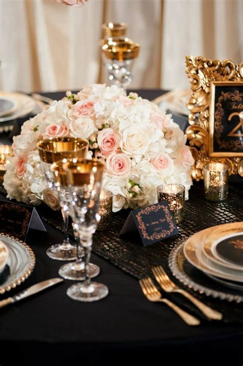 Blush ivory black and gold wedding centerpieces   Unique