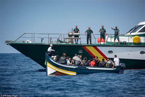 boat crew in spanish desperate 300 migrants rescued from tiny boats as they try