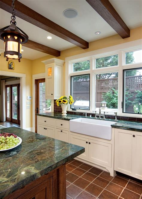 forest green marble countertops add gorgeous color to this kitchen design a large white