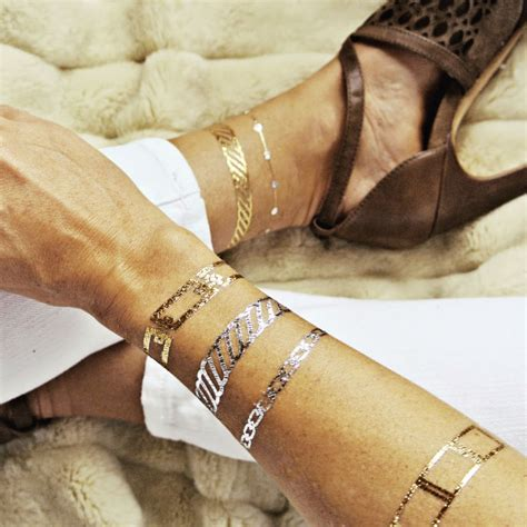 hot new trend alert rock gilded temporary tattoos like the beauty buzz with laurie fall beauty trends flower