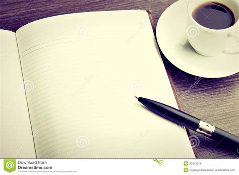 Open A Blank White Notebook, Pen And Coffee On The Desk Royalty Free Stock Image   Image: 33418016