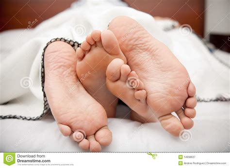 bed feet couple s feet stock image image of relaxing laying